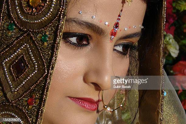 Portrait of bride wearing traditional nose ring