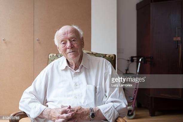 Portrait of bright 94-year-old man at home