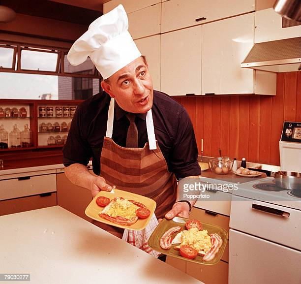 A portrait of British actor Alfred Marks cooking the picture shows him holding two plates of fried English breakfasts