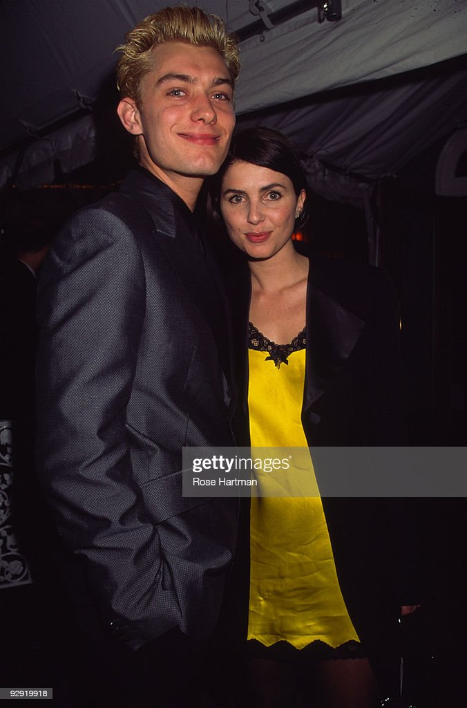 Portrait of British actor Jude Law and his girlfriend actress and fashion designer Sadie Frost as they attend the opening night party at Tavern on...