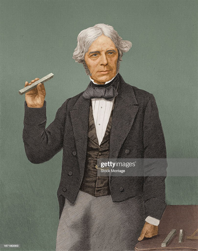 Portrait of British chemist and physicist Michael Faraday as he stands holding a piece of special glass which he used in experiments exploring the...