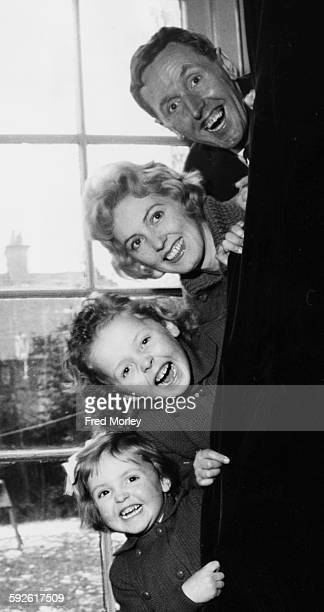 Portrait of British comic actor Cardew 'the Cad' Robinson and his family his wife and daughters Julie and Linda Kim at their home in Hendon London...