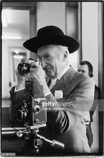 Portrait of British fashion photographer Cecil Beaton as he takes photographs in Andy Warhol's studio the Factory New York New York April 24 1969