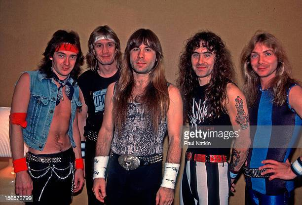 Portrait of British heavy metal band Iron Maiden backstage at the Poplar Creek Music Theater in Hoffman Estates during their World Slavery Tour...