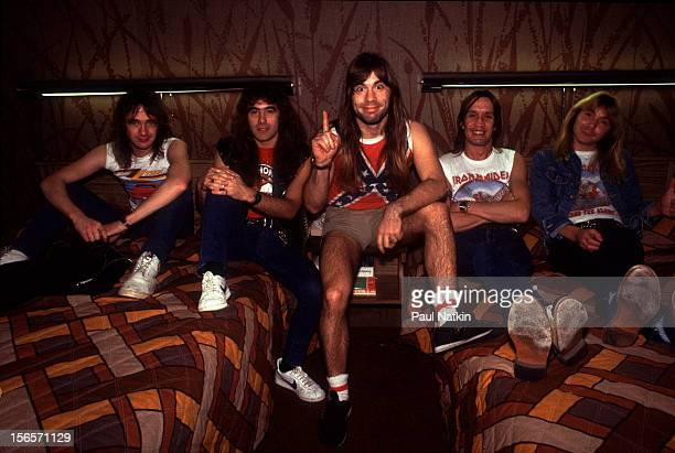 Portrait of British heavy metal band Iron Maiden in an hotel room before a show at the Holiday Star Theater during their Beast on the Road Tour...