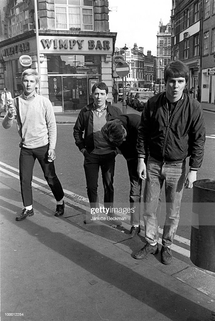 Portrait of British mod rock group Purple Hearts as they clown about in Soho, London, England, 1980. Pictured are, from left, bass player Jeff Shadbolt, drummer Gary Sparks, guitarist Simon Stebbing, and singer Bob Manton.