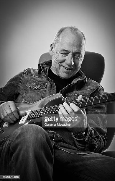 Portrait of British musician and composer Mark Knopfler photographed with his custom Pensa Blue electric guitar at his studio in London on February 6...