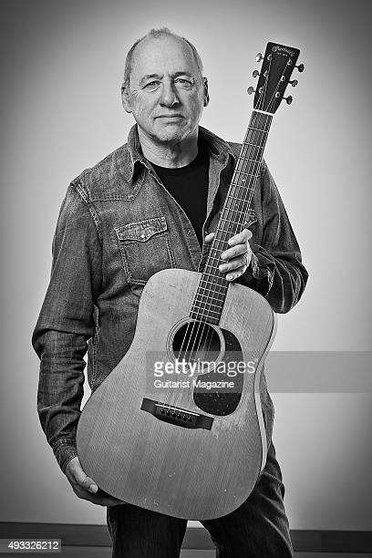 Portrait of British musician and composer Mark Knopfler photographed with vintage 1930's Martin D18 acoustic guitar at his studio in London on...