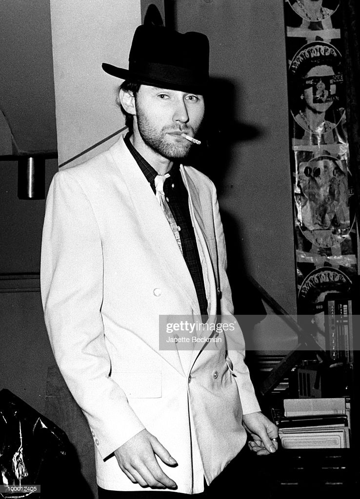 Portrait of British musician Jah Wobble of the post-punk band Public Image Ltd as smokes a cigarette in band leader John Lydon's apartment, London, England, 1979.