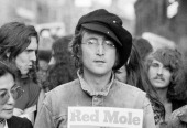 Portrait of British musician John Lennon and his wife artist and musician Yoko Ono as they attend an unspecified rally in Hyde Park London England...