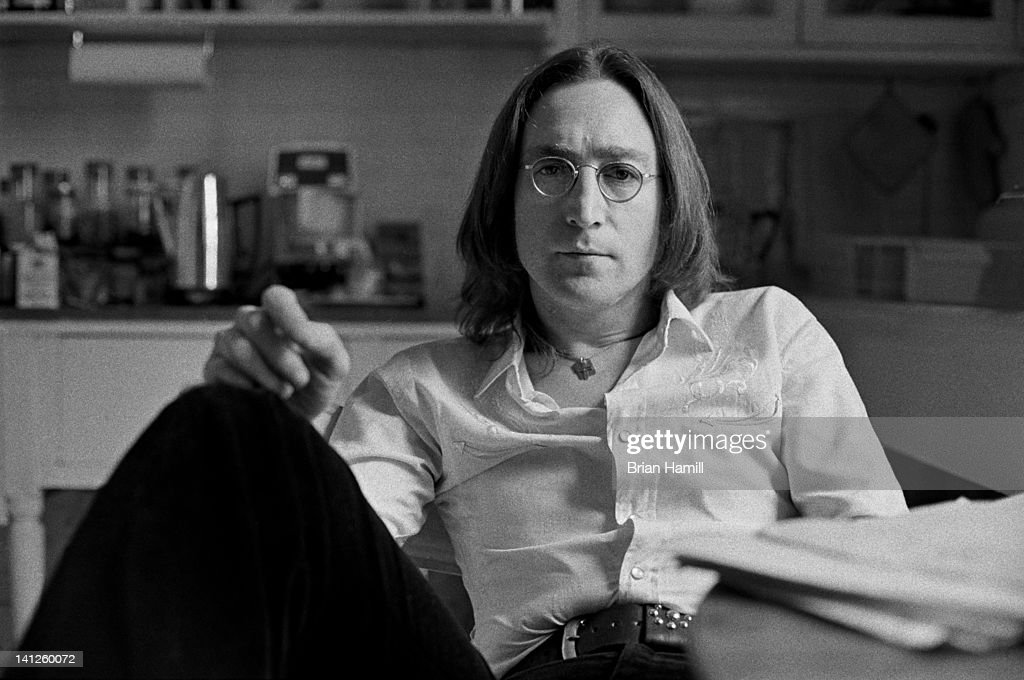 Portrait of British musician <a gi-track='captionPersonalityLinkClicked' href=/galleries/search?phrase=John+Lennon&family=editorial&specificpeople=91242 ng-click='$event.stopPropagation()'>John Lennon</a> (1940 - 1980) in the kitchen of his apartment in the Dakota (1 West 72nd Street), New York, New York, 1975.