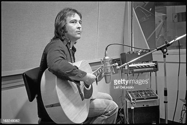 Portrait of British musician Mick Jones of the band Foreigner plays guitar in Atlantic Recording Studios during the recording of his band's...