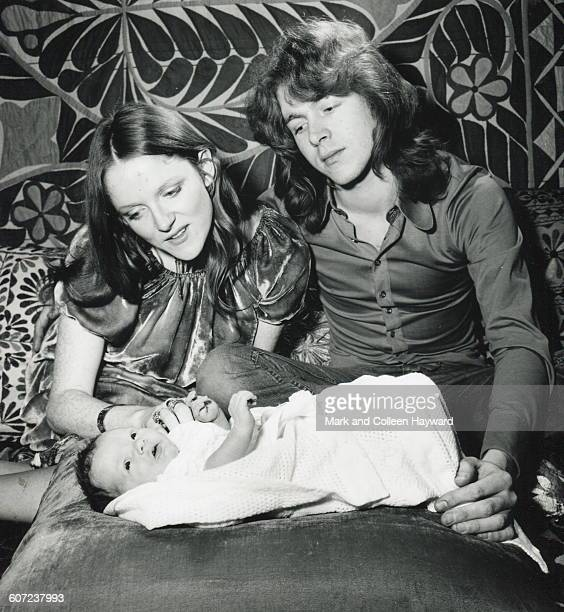 Portrait of British musician Mick Taylor and his wife Rose Millar as they pose with their nineday old daughter Chloe January 15 1971