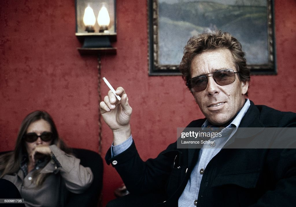 Portrait of British photographer Antony Armstrong-Jones, 1st Earl of Snowdon (professionally known as Snowdon), a cigarette in his hand, 1974.