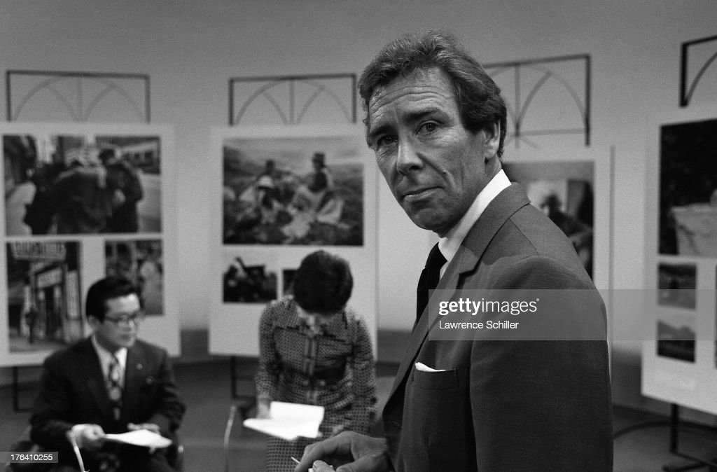 Portrait of British photographer Antony Armstrong-Jones, 1st Earl of Snowdon (professionally known as Snow don), prior to a television interview, Tokyo, Japan, 1974. He was in Japan for his 'Assignments' exhibition, examples of which are on the walls in the background.