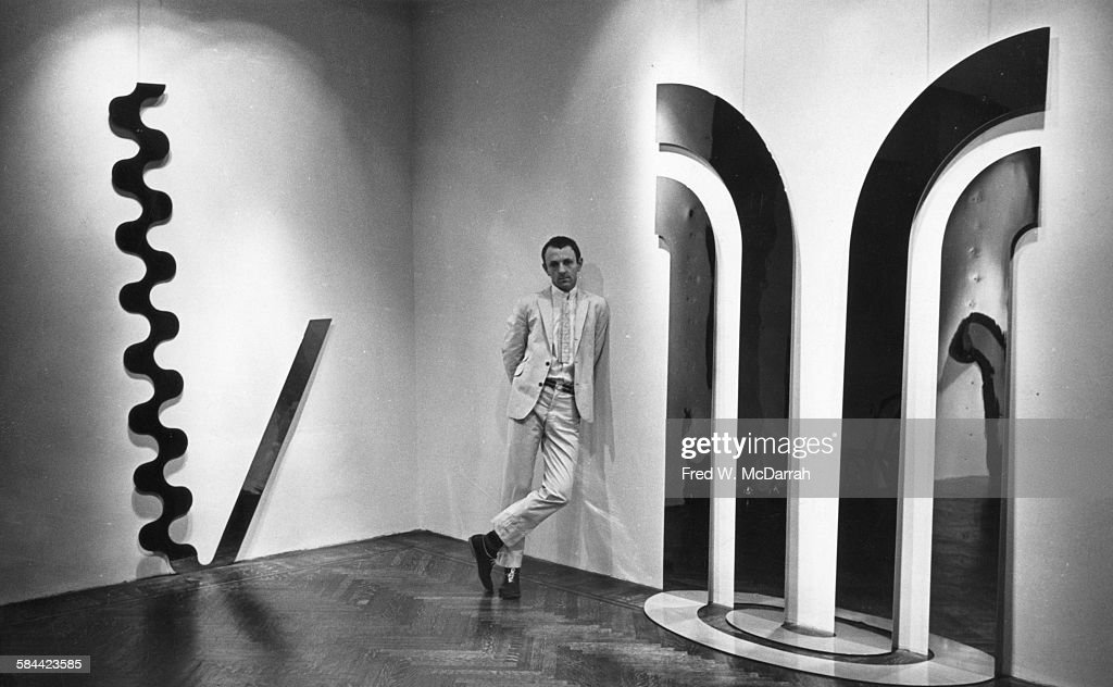 Portrait of British Pop artist <a gi-track='captionPersonalityLinkClicked' href=/galleries/search?phrase=Gerald+Laing&family=editorial&specificpeople=1297216 ng-click='$event.stopPropagation()'>Gerald Laing</a> (1936 - 2011) as he poses with his work at the Richard L Feigen Gallery, New York, New York, November 6, 1965.