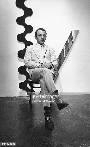 Portrait of British Pop artist Gerald Laing as he poses with his work at the Richard L Feigen Gallery New York New York November 6 1965