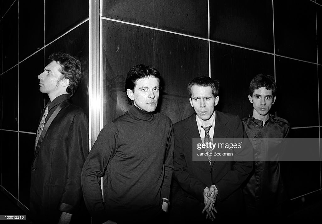 Portrait of British post-punk group the Monochrome Set, London, England, late 1970s. Pictured are, from left, Canadian guitarist Lester Square (born Thomas W.B. Hardy), bass player Jeremy Harrington, drummer John D. Haney, and singer and guitarist Bid (born Ganesh Seshadri).