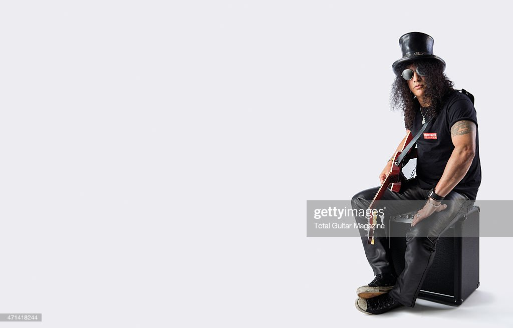 Portrait of British-American musician Saul Hudson, better known by his stage name Slash, photographed with his Gibson Slash Vermillion Les Paul electric guitar in London on June 2, 2014.