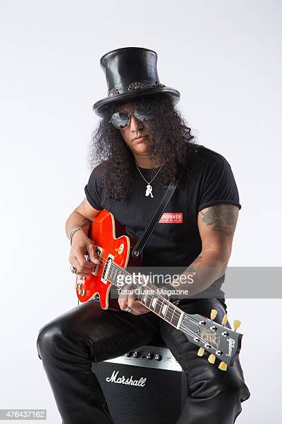 Portrait of BritishAmerican musician Saul Hudson better known by his stage name Slash photographed with his Gibson Slash Vermillion Les Paul electric...