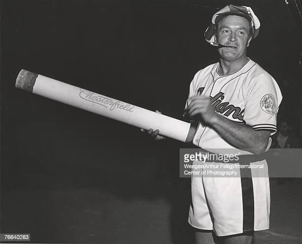 Portrait of Britishborn American comedian and radio televison personality Bob Hope dressed in a Cleveland Indians baseball jersey boxing trunks and a...