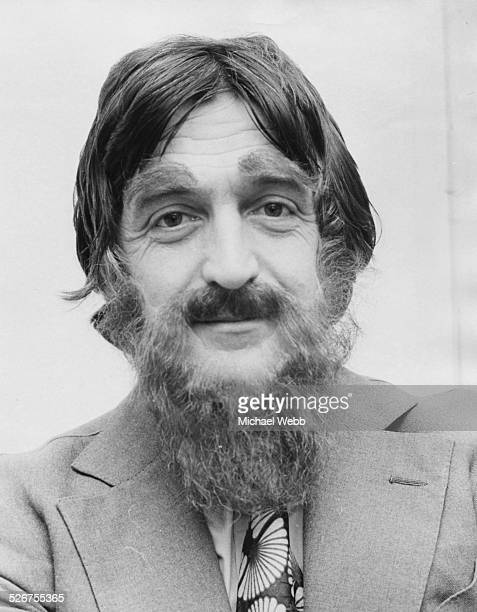 Portrait of broadcaster and journalist Michael Parkinson in disguise wearing a false beard and eyebrows to visit the first menonly barber shop opened...