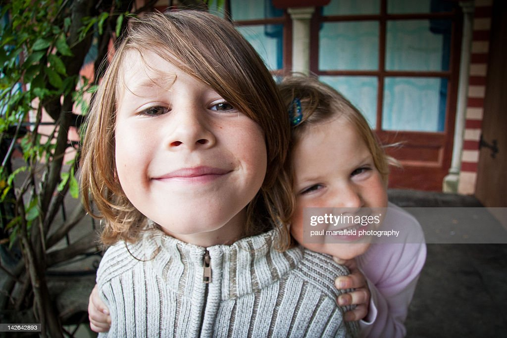 Portrait of brother and sister smiling : Stock Photo