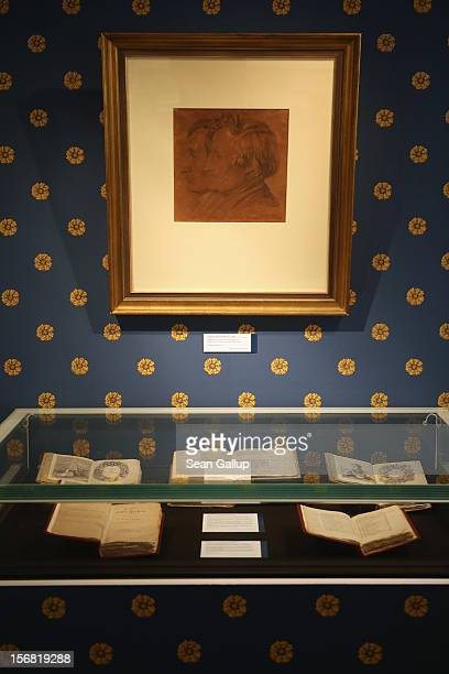 A portrait of brothers Jacob and Wilhelm Grimm hangs over secondedition books of Grimms' Fairy Tales at the Grimm Brothers Museum on November 20 2012...