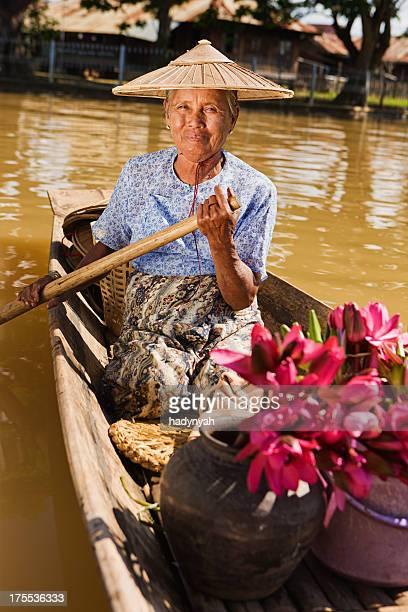 Portrait of burmese woman selling lotus flowers on floating market