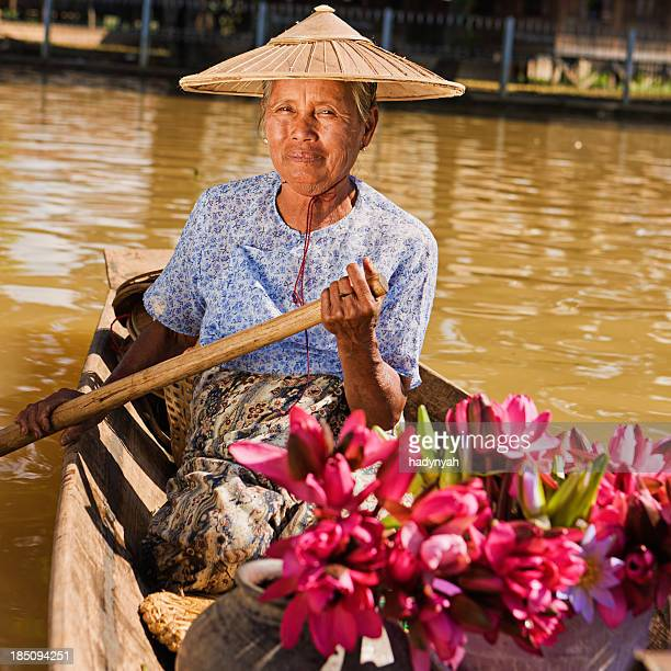 Portrait of burmese woman selling lotus flowers on floating market