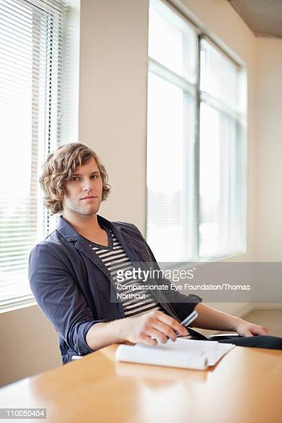 Portrait of business casual man at a table