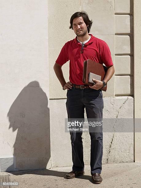 portrait of business man in street