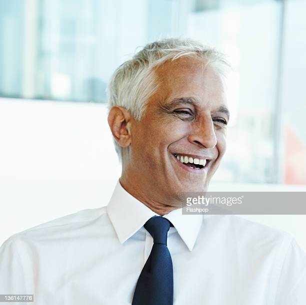 Portrait of business man laughing