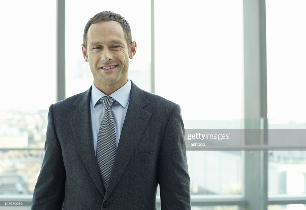 Portrait of business man smiling : Stock Photo
