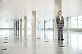 Portrait of business man tied to pillar