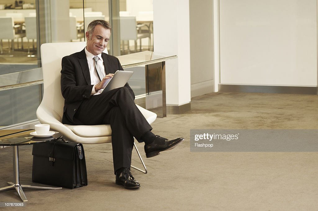 Portrait of business man using computer tablet : Stock Photo