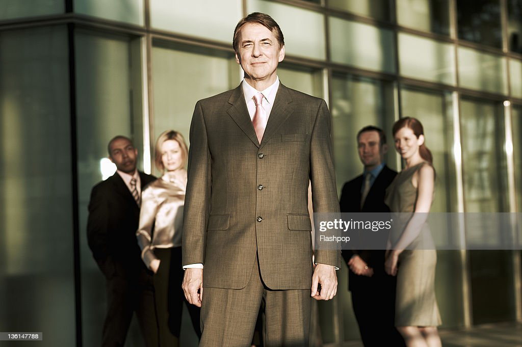 Portrait of business man with group of colleagues : Stock Photo