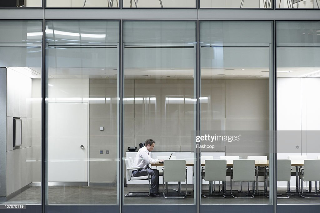 Portrait of business man working late : Stock-Foto