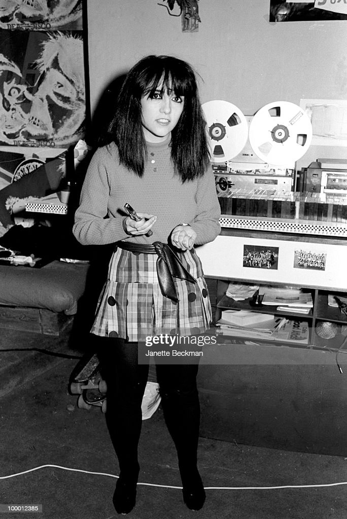 Portrait of business manager of post-punk band Public Image Ltd Jeannette Lee as she uses a nutcracker in band leader John Lydon's apartment, London, England, 1979.