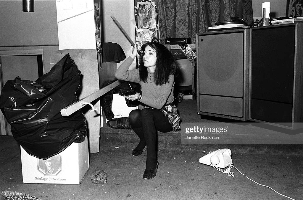 Portrait of business manager of post-punk band Public Image Ltd Jeannette Lee as she eats a handful of nuts in band leader John Lydon's apartment, London, England, 1979.