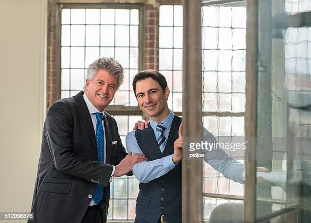 portrait of business partners smiling in an office