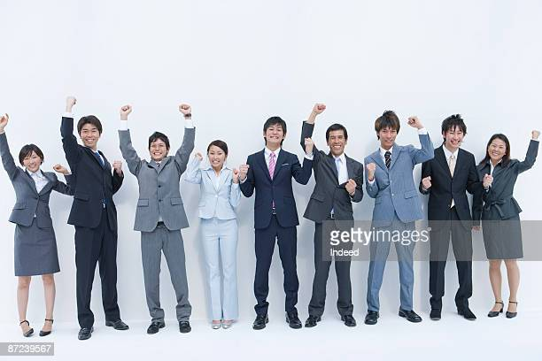 Portrait of business people, clenching fists