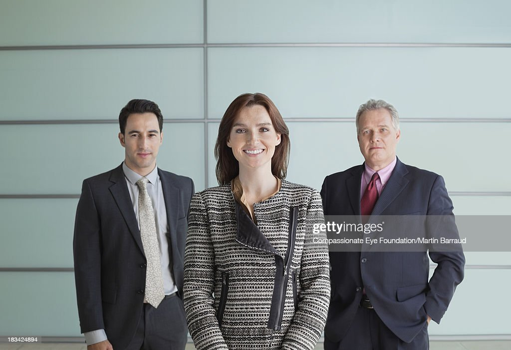 Portrait of business people in lobby : Stock Photo