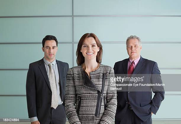 Portrait of business people in lobby