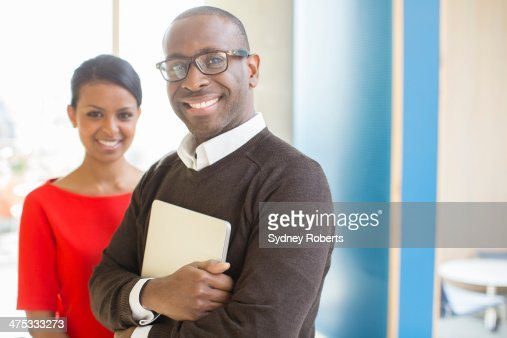Portrait of business people in modern office : Stock Photo