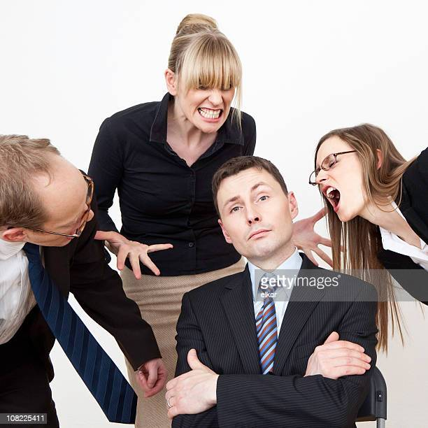 Portrait of Business Team Yelling at Ignorant Businessman