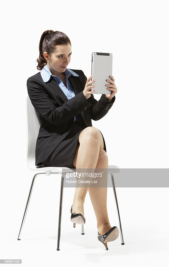 Portrait of business woman seated using tablet : Stock Photo