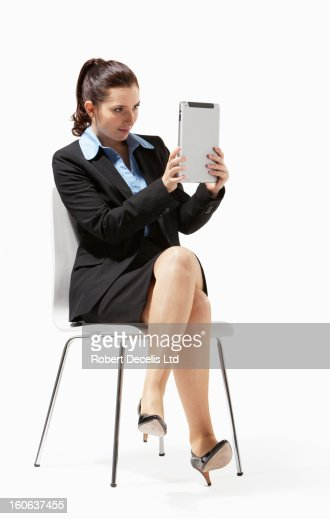 Portrait of business woman seated using tablet : ストックフォト