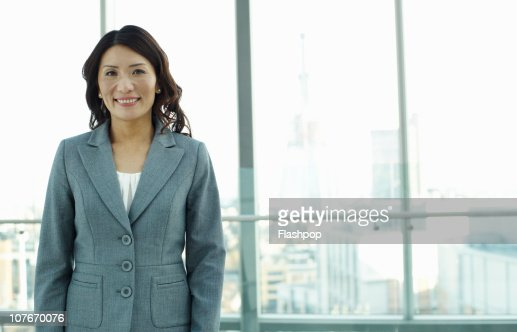 Portrait of business woman smiling to camera : Stock Photo