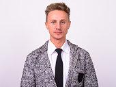 Studio Shot Of Businessman Against White Background